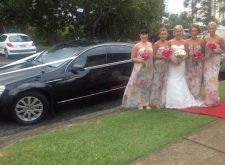 Bride and bridal party with our black wedding car