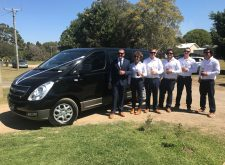 Groom and groomsmen with our black mini van
