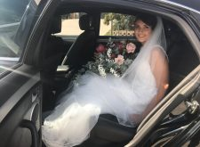 Bride in our black wedding car