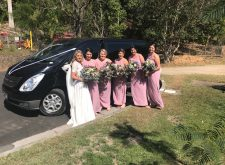Bride and bridal party with our luxury black mini van